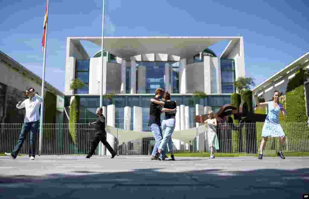 People dance in front of the Chancellery, office of German Chancellor Angela Merkel, in Berlin, on the occasion of the action day 'Save the world cultural heritage Tango Argentino in Germany.'