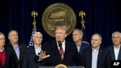 President Donald Trump, center, accompanied by from left, Senate Majority Leader Mitch McConnell of Kentucky, Vice President Mike Pence, House Majority Leader Kevin McCarthy of California, House Majority Whip Steve Scalise, R-La., and Secretary of State R