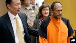 FILE - Jose Ines Garcia Zarate, right, is led into the courtroom by San Francisco Public Defender Jeff Adachi, left, and Assistant District Attorney Diana Garcia, center, for his arraignment in San Francisco, July 7, 2015.