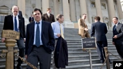 "Rep. Raul Labrador (2nd from L) and members of the House of Representatives leave after the Republican-controlled House voted to let insurance companies sell individual health coverage to all comers, even if it falls short of required standards in ""Obamac"