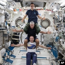 Russia's Alexander Misurkin, bottom, NASA's Mark Vande Hei, middle, and NASA's Joe Acaba at the International Space Station, Feb. 25, 2018. The three astronauts flew back to Earth Tuesday, following a nearly six-month mission at the International Space S