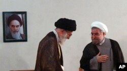 Vrhovni iranski lider Ajatola ali Hamenei i novo izabrani predsednik Hasan Rohani, 16. juni, 2013.