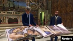 Two 1:1 scale photographic books depicting Sistine Chapel are seen during a news conference in the Sistine Chapel, the Vatican, Feb. 24, 2017.