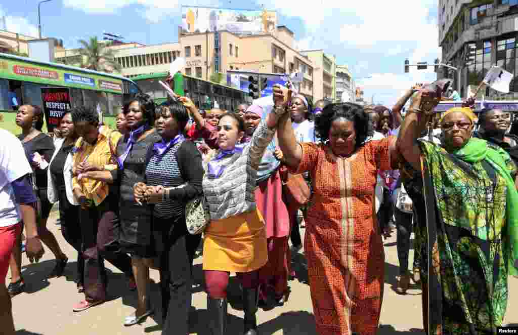 Women take part in a protest along a main street in the Kenyan capital of Nairobi. The demonstrators were demanding justice for a woman who was attacked and stripped recently in Nairobi by men who claimed that she was dressed indecently.