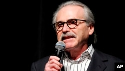 FILE - David Pecker, chairman and CEO of American Media, addresses those attending a Super Bowl party in New York, Jan. 31, 2014.