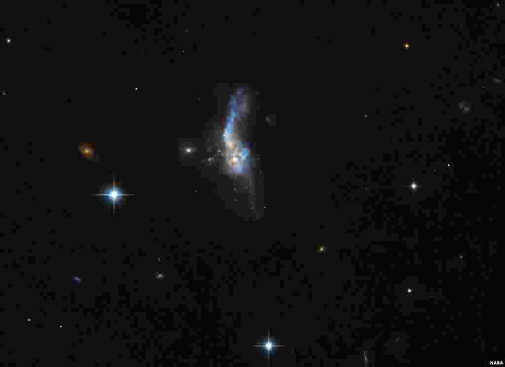 This celestial object called IRAS 14348-1447 is actually a combination of two gas-rich spiral galaxies. It is located over a billion light-years away from us. It is one of the most gas-rich examples known of an ultraluminous infrared galaxy, a class of cosmic objects that shine characteristically — and incredibly — brightly in the infrared part of the spectrum. The image was taken by Hubble's Advanced Camera for Surveys.