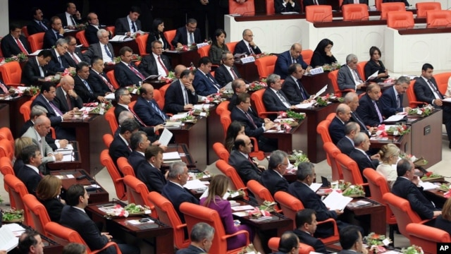 The newly-elected lawmakers from pro-Kurdish Peace and Democracy Party, last two rows, sit  the parliament with the members of other parties in Ankara, Turkey, October 1, 2011.