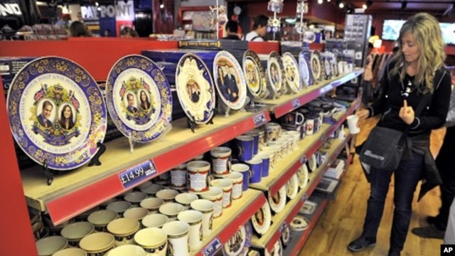A woman views crockery featuring images of Britain's Prince William and his fiancee Kate Middleton in a souvenir shop in Piccadilly Circus in central London