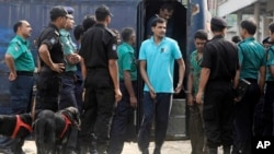 Handcuffed border guards arrive at a special court in Dhaka, Bangladesh, Nov. 5, 2013.