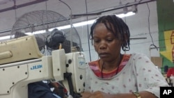 Gertha Jezulien has returned to work at the Island Apparel garment factory in Port-au-Prince, Haiti, 26 Jan 2010