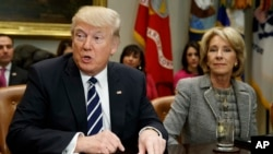 President Donald Trump accompanied by Education Secretary Betsy DeVos, speaks during a meeting with parents and teachers, Feb. 14, 2017, in the Roosevelt Room of the White House in Washington.
