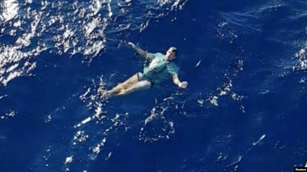 A man who used his jeans as a makeshift flotation device, after being knocked off a yacht and stranded at sea, is rescued by a helicopter, off Tolaga Bay in Gisborne, New Zealand, March 6, 2019. (Lowe Corporation Rescue Helicopter Service/Handout via REUTERS)