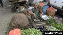 A SEWA vegetable vendor.