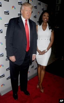 Donald Trump and Omarosa Manigault Newman at a promotional event for 'The Apprentice' in New York City.