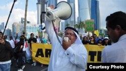 Người biểu tình tuần hành trên đường phố của Doha trong lúc hội nghị khí hậu đang tiếp diễn. (Richard Casson, Oxfam)