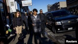 Baltimore mayor Stephanie Rawlings-Blake tours Pennsylvania Avenue as Maryland State Police stand guard in Baltimore, Maryland, April 28, 2015.