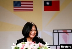 FILE - Taiwanese President Tsai Ing-wen speaks in the Los Angeles Overseas Chinese Banquet during visit in Los Angeles, California, Aug. 12, 2018.