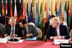 FILE - Britain's Foreign Secretary Boris Johnson (R) and French Foreign Minister Jean-Marc Ayrault (L) attend a ministerial summit to hold discussion on the future of Mosul city, post-Islamic State, in Paris, France, Oct. 20, 2016.