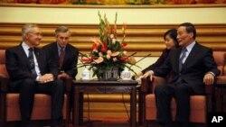 里德與中國副總理王歧山會面。