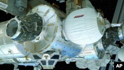 FILE - This illustration provided by Bigelow Aerospace on April 6, 2016, shows the Bigelow Expandable Activity Module (BEAM), center right, attached to the International Space Station.