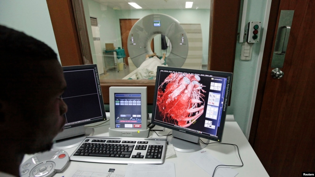 FILE - A doctor checks a screen showing a graphical representation of a human heart. A new study suggests that patients who see their clogged arteries are more likely to make and keep a heart-healthy lifestyle.