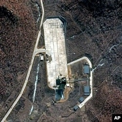 FILE - Satellite file image provided by DigitalGlobe shows North Korea's Tongchang-ri launch facility on the nation's western coast.