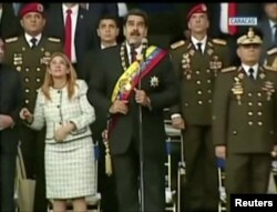 Venezuelan President Nicolas Maduro reacts during an event that was interrupted, reportedly by explosives from drones, in this still frame taken from government video, Aug. 4, 2018, in Caracas, Venezuela.