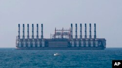 A floating power station waits off the coast at Jiyeh, south of Beirut, Lebanon, July 16, 2018.