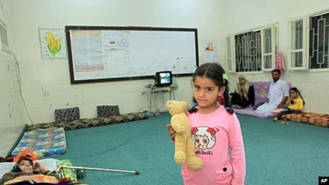 Five-year-old Razan's home in Misrata, Libya, was destroyed by a missile. She now lives in a school in the city with her parents, sister and 76-year-old diabetic grandmother.