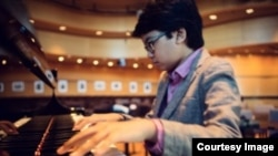 Joey Alexander checks out a piano at Dizzy's Club Coca Cola, a jazz club at Jazz at New York City's Lincoln Center. (Courtesy - ShoreFire Media)