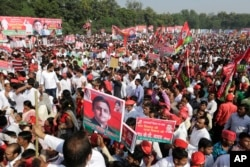 Samajwadi Party supporters hold the poster of their leader Akhilesh Yadav for the launch of the party's election campaign for the state of Uttar Pradesh, in Lucknow, India, Nov. 3, 2016. The opaque funding of political parties has become a growing source of concern in the world's largest democracy.
