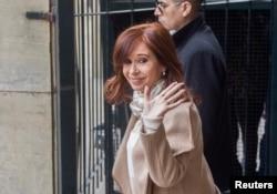 FILE - Former Argentine President Cristina Fernandez de Kirchner waves as she leaves the Justice Building in Buenos Aires, Argentina, Sept. 3, 2018.