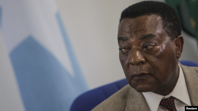 Augustine Mahiga, Special Representative of the United Nations Secretary-General for Somalia and head of the U.N. Political Office in Somalia (UNPOS), looks on during a news conference in Mogadishu August 19, 2012.