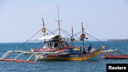 A fishing boat used to fish in the disputed Scarborough Shoal, in South China Sea is pictured in Masinloc, Zambales in the Philippines April 22, 2015.