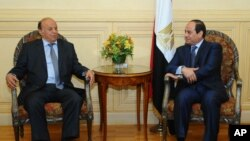 President Abed Rabbo Mansour Hadi, right, meets with Egyptian President Abdel Fattah al-Sissi after his arrival to attend an Arab summit in Sharm el-Sheikh, March 27, 2015.