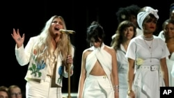 "Kesha singing ""Praying"" while singers Camila Cabello, center, and Andra Day stand by at the 60th annual Grammy Awards at Madison Square Garden on Sunday, Jan. 28, 2018, in New York."