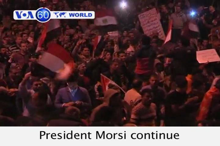 Protests against President Morsi continue in Cairo ahead of Saturday's constitutional referendum.
