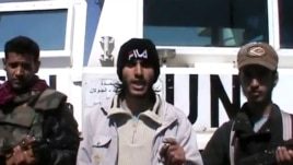 An image taken from a video uploaded on YouTube on March 6, 2013 allegedly shows armed fighters standing in front of a United Nations Disengagement Force (UNDOF) vehicle in the Golan Heights between Syria and Israel.