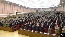 Delegates clap in union during the ruling Workers' Party representatives meeting in Pyongyang, North Korea, 28 Sep 2010