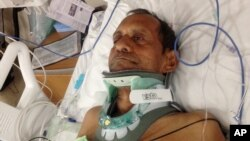FILE - Sureshbhai Patel is shown in a February 7, 2015, photo in a bed at Huntsville Hospital in Huntsville, Alabama.