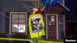 A makeshift memorial pays tribute to a 19-year-old black man killed by police, in front of a home cordoned off with barricade tape on Williamson Street in Madison, Wisconsin, March 7, 2015.
