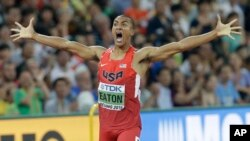 United States' Ashton Eaton celebrates as he crosses the finish line after his decathlon 400m race at the World Athletics Championships at the Bird's Nest stadium in Beijing, Aug. 28, 2015.