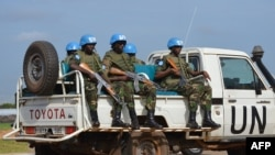 UN peacekeepers secure a section of the airport as members of the United Nations Security Council arrive in the South Sudanese capital, Juba, on August 12, 2014. (AFP)