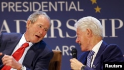 Former U.S. Presidents George W. Bush (L) and Bill Clinton share a laugh during a moderated conversation at the graduation of the inaugural class of the Presidential Leadership Scholars program, a partnership between the presidential centers of George W.