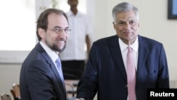 FILE - U.N. High Commissioner for Human Rights Zeid Ra'ad Al Hussein, left, shakes hands with Sri Lankan Prime Minister Ranil Wickremesinghe during their meeting in Colombo, Feb. 9, 2016. The human rights chief was assessing the country's progress in prosecuting alleged war crimes.