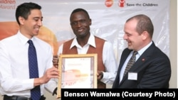 Dr. Benson Wamalwa (Center) receives an award from GSK-Save the Children Partnership.
