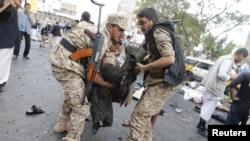 На месте взрыва на площади Тахрир. Сана. Йемен. 9 октября 2014 г.