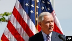 FILE - Attorney General Jeff Sessions speaks at a news conference after touring the U.S.-Mexico border, April 11, 2017, in Nogales, Ariz. Sessions announced making immigration enforcement a key Justice Department priority.