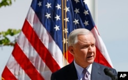 FILE - Attorney General Jeff Sessions speaks at a news conference after touring the U.S.-Mexico border with border officials, April 11, 2017, in Nogales, Ariz.