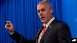 FILE - Interior Secretary Ryan Zinke speaks on the Trump administration's energy policy at the Heritage Foundation in Washington, Sept. 29, 2017.
